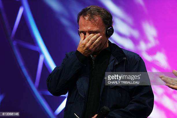 Greek photographer Yannis Behrakis reacts as he receives the Photo Trophy awarded by Nikon during the closing ceremony of the 2016 BayeuxCalvados...