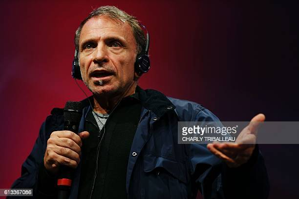Greek photographer Yannis Behrakis speaks after receiving the Photo Trophy awarded by Nikon during the closing ceremony of the 2016 BayeuxCalvados...