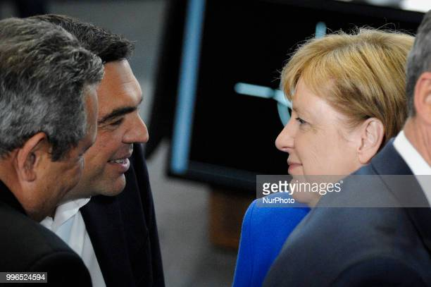 Greek PM Alexis Tsipras is seen speaking with German chancellor Angela Merkel during the 2018 NATO Summit in Brussels Belgium on July 11 2018