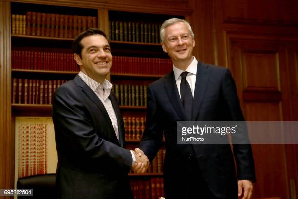Greek PM Alexis Tsipras welcomes French Minister of Economy Bruno Le Maire at Maximos mansion in Athens on June 12 2017