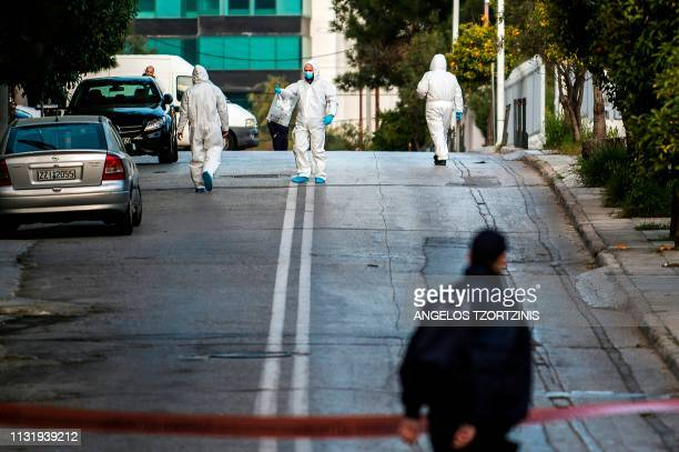 Greek police experts search the area outside the Russian consulate in Athens on March 22 2019 A grenade was thrown early on March 22 into the...