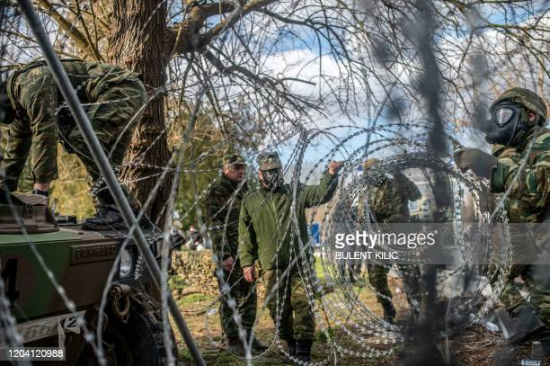 Greek police install new barbed wire fence at the buffer zone at TurkeyGreece border at Pazarkule in Edirne district on February 29 2020 Thousands of...
