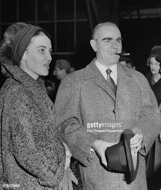 Greek politician and Prime Minister of Greece Konstantinos Karamanlis and his wife Amalia Karamanlis arrive at Victoria Station in London for a...
