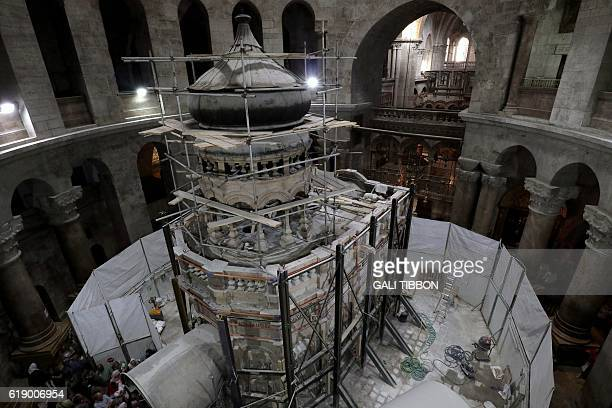 Greek preservation experts work to strengthen the Edicule surrounding the Tomb of Jesus where his body is believed to have been laid as part of...