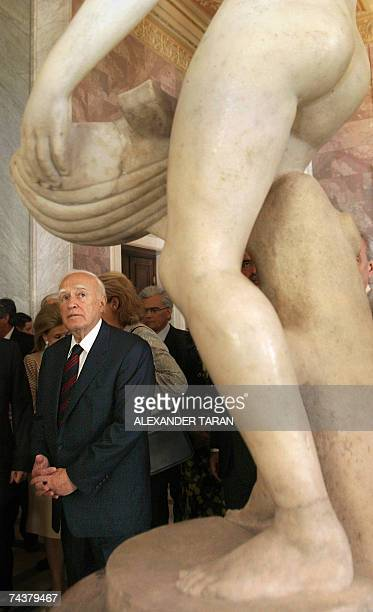 Greek President Carolos Papoulias looks at a sculpture during his visit in the Hermitage state museum in StPetersburg 02 June 2007 Carolos Papoulias...