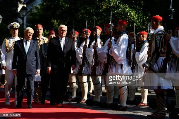 Greek President Prokopis Pavlopoulos and his German counterpart FrankWalter Steinmeier review the Greek Presidential guard before their meeting in...
