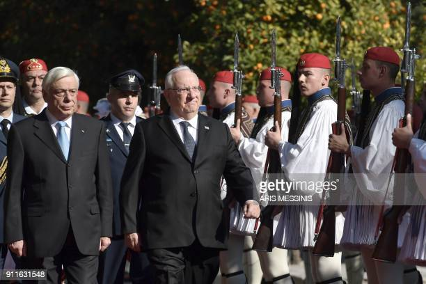 Greek President Prokopis Pavlopoulos and his Israeli counterpart Reuven Rivlin review the Greek Presidential Guard before their meeting in Athens on...
