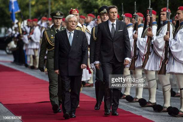 Greek President Prokopis Pavlopoulos and his Slovenian counterpart Borut Pahor review the Greek Presidential guard before their meeting in Athens on...