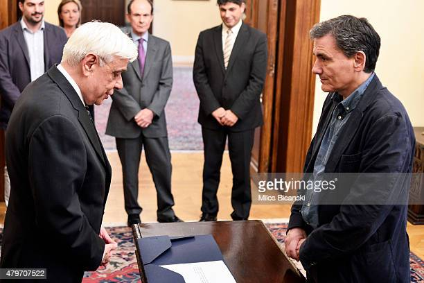 Greek President Prokopis Pavlopoulos and new Greek Finance Minister Euclid Tsakalotos at the presidential palace during the swearing in ceremony of...