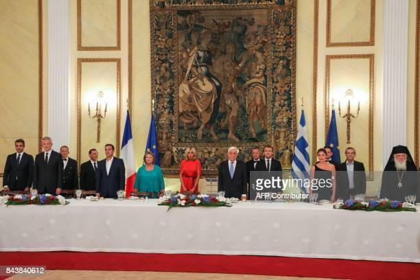 Greek President Prokopis Pavlopoulos French President Emmanuel Macron Pavlopoulos' wife Vlassia PavlopoulouPeltsemi Macron's wife Brigitte Macron...