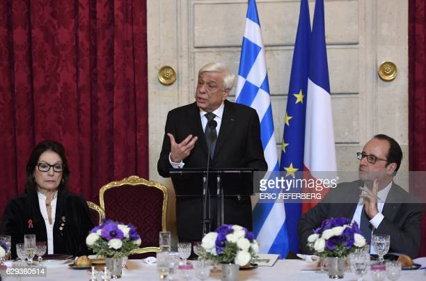 Greek President Prokopis Pavlopoulos speaks next to French President Francois Hollande and Greek singer Nana Mouskouri on December 12 2016 during a...