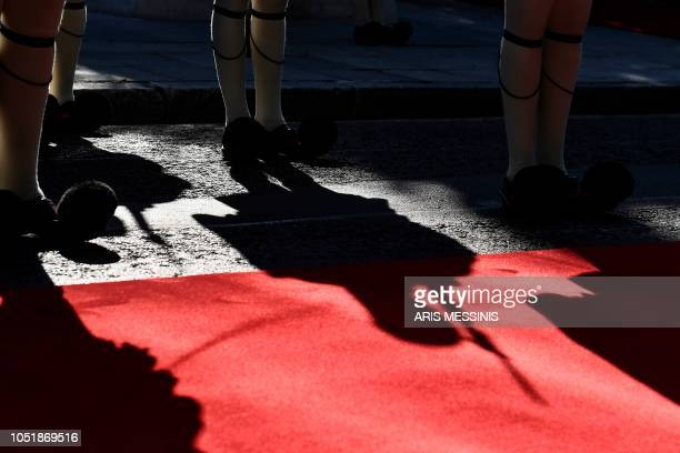 A Greek Presidential guard member casts a shadow on a carpet during an official visit of the German President Frank Walter Steinmeier in Athens on...
