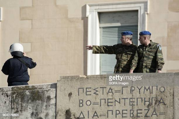 Greek Presidential Guards and a policeman seen outside the Greek Parliament during a demonstration against the voting of the new Multibill of the...