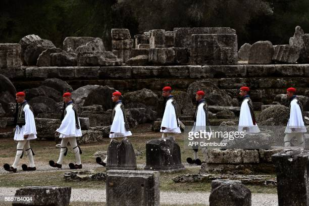 Greek Presidential guards or Evzones walk across the ancient archeological site at the Temple of Hera in Olympia on October 24 2017 during the...