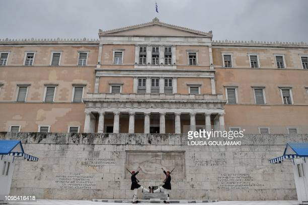 Greek Presidential guards perform in front of the Greek Perliament building in Athens on February 8, 2019. - Greek Parliament is expected on February...