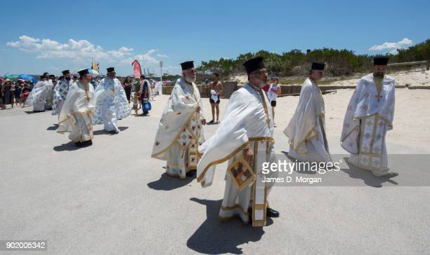 Greek priests parade together at the Greek Orthodox Epiphany Day festival at Yarra Bay on January 7 2018 in Sydney Australia 'Epiphany' according to...