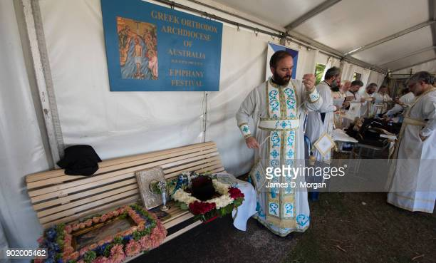 Greek priests prepare before the parade at the Greek Orthodox Epiphany Day festival at Yarra Bay on January 7 2018 in Sydney Australia 'Epiphany'...