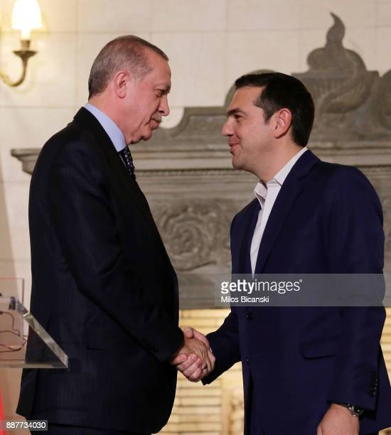 Greek prime minister Alexis Tcipras shake hand Turkish President Recep Tayyip Erdogan after a joint press conference the in Athens on December 7 2017...
