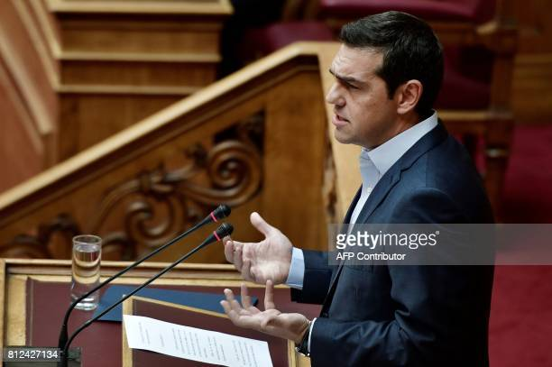Greek prime minister Alexis Tsipras addresses the Greek parliament on the recent Cyprus talks on July 11 2017 in Athens Turkish President Recep...
