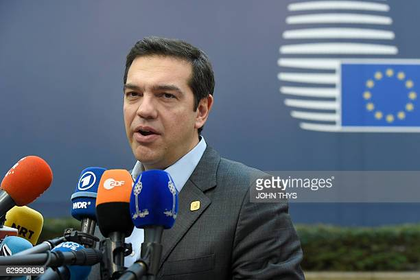 Greek Prime Minister Alexis Tsipras addresses the medias as he arrives for a European Union leaders summit focused on Russia sanctions and migration...