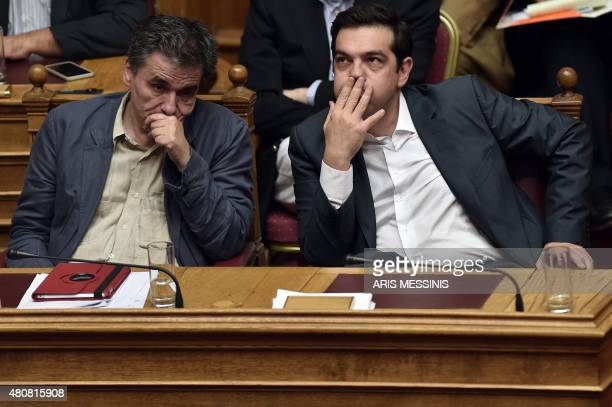 Greek Prime Minister Alexis Tsipras and Finance Minister Eyclid Tsakalotos react during a parliament session in Athens on July 15 2015 AFP PHOTO /...