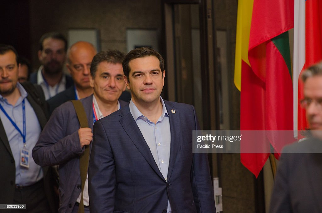 Greek Prime Minister Alexis Tsipras (front) and Greek... : News Photo