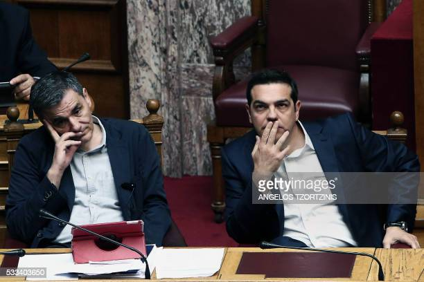 Greek Prime Minister Alexis Tsipras and Greek Finance Minister Euclid Tsakalotos attend a parliamentary session in Athens on May 22, 2016. - Greece...