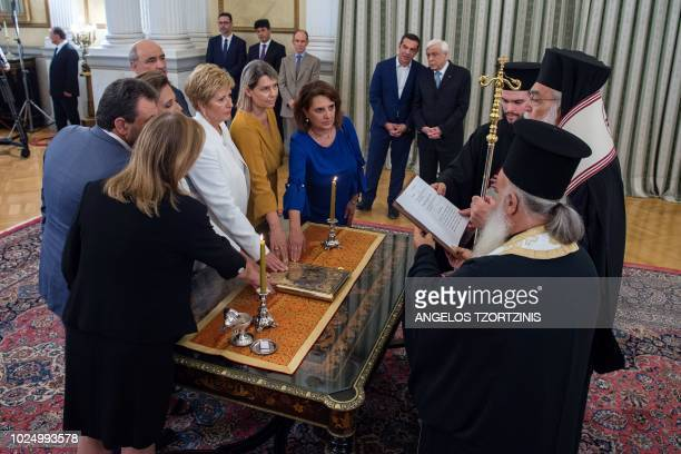 Greek Prime Minister Alexis Tsipras and Greek President Prokopis Pavlopoulos speak as they attend a swearingin ceremony of newly appointed members of...