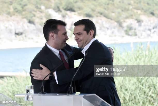Greek Prime Minister Alexis Tsipras and Macedonian Prime Minister Zoran Zaev hug during a signing ceremony between officials from Greece and...