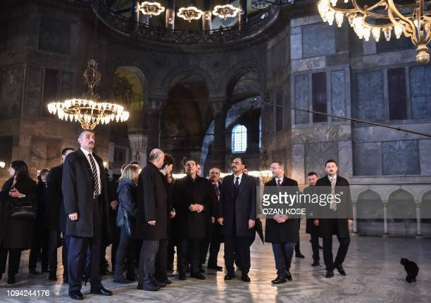 Greek Prime Minister Alexis Tsipras and Turkish officials visit the Byzantineera Hagia Sophia museum on February 6 in Istanbul Tsipras is on an...