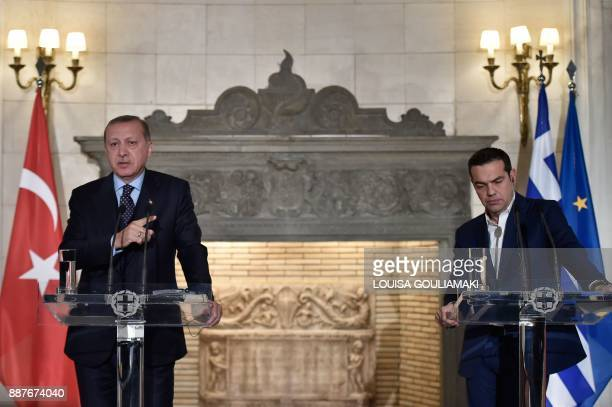 Greek Prime Minister Alexis Tsipras and Turkish President Recep Tayyip Erdogan deliver a joint press conference in Athens on December 7 2017...