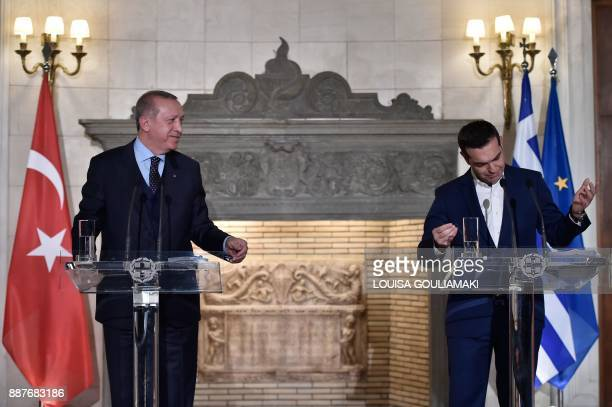 TOPSHOT Greek Prime Minister Alexis Tsipras and Turkish President Recep Tayyip Erdogan deliver a joint press conference in Athens on December 7 2017...