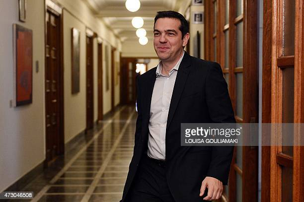 Greek Prime Minister Alexis Tsipras arrives for a cabinet meeting at the parliament in Athens on May 12 2015 Greece is in urgent need of cash with...