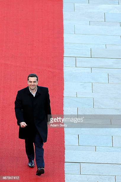 Greek Prime Minister Alexis Tsipras attends a military welcome ceremony upon arrival for talks with German Chancellor Angela Merkel at the German...
