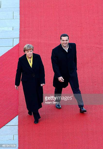 Greek Prime Minister Alexis Tsipras attends a military welcome ceremony with German Chancellor Angela Merkel upon Tsipras' arrival for talks at the...