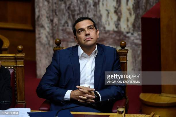 Greek Prime Minister Alexis Tsipras attends a parliamentary session in Athens on June 14 2018 as the Greek opposition calls a censure vote against...