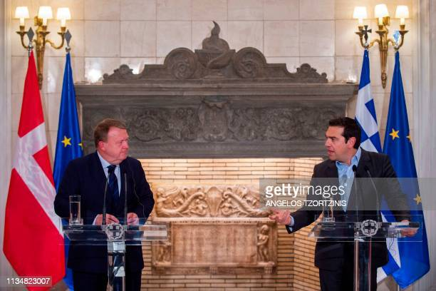 Greek Prime Minister Alexis Tsipras chats with his Danish counterpart Lars Lokke Rasmussen during their joint press conference, following their...