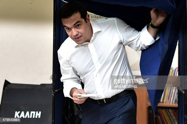 Greek Prime Minister Alexis Tsipras comes out of a polling booth during the Greek referendum in Athens on July 5 2015 Greek voters headed to the...