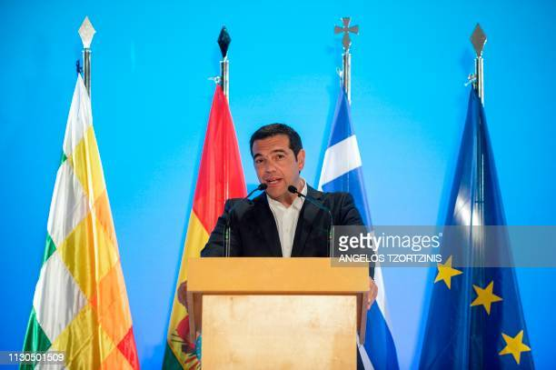 Greek Prime Minister Alexis Tsipras delivers a speech during a conference at the Stavros Niarchos Foundation Cultural Center in Athens on March 14 as...