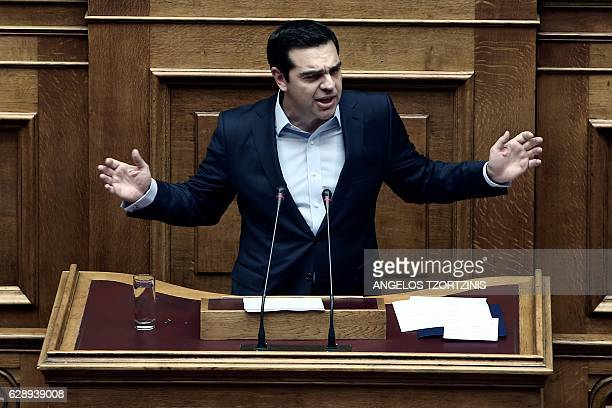 Greek Prime Minister Alexis Tsipras delivers a speech during a parliamentary session in Athens on December 10 2016 / AFP / Angelos Tzortzinis