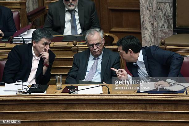 Greek Prime Minister Alexis Tsipras Deputy Prime Minister Yannis Dragasakis and Finance Minister Euclid Tsakalotos talk during a parliamentary...