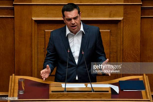Greek Prime minister Alexis Tsipras gestures as he addresses lawmakers prior the confidence vote at the Greek parliament on May 10 2019