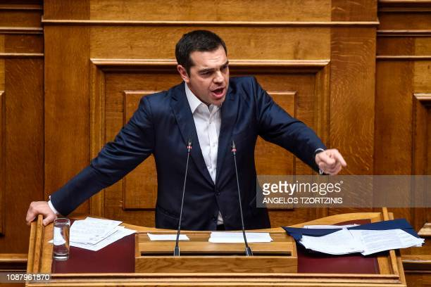 Greek Prime Minister Alexis Tsipras gestures as he delivers a speech during a session at the Greek Parliament in Athens on January 24 2019 Greece's...