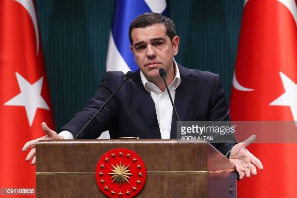 Greek Prime Minister Alexis Tsipras gestures as he speaks during a joint press conference with Turkish President following a meeting at the...