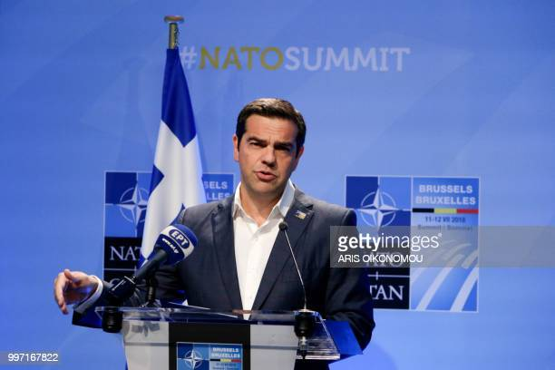 Greek Prime Minister Alexis Tsipras gives a press conference at the end of the second day of the NATO Summit and a bilateral meeting with Turkish...
