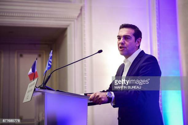 Greek Prime Minister Alexis Tsipras gives a speech after receiving a prize rewarding political courage from International Politics magazine director...