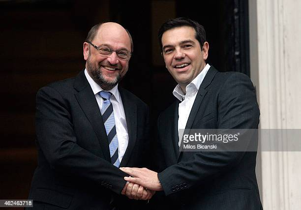 Greek Prime Minister Alexis Tsipras greets European Parliament President Martin Schulz at his office prior to their meeting on January 29 2015 in...
