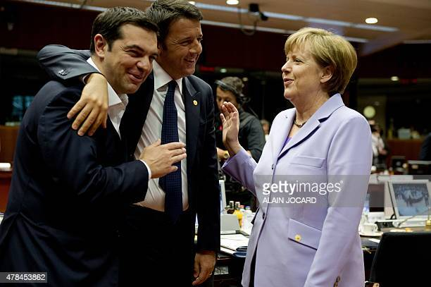 Greek prime minister Alexis Tsipras his Italian counterpart Matteo Renzi and German Chancellor Angela Merkel share a light moment before the start of...