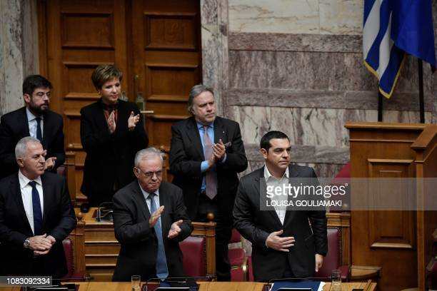 Greek Prime Minister Alexis Tsipras is applauded by lawmakers after his speech on January 15 2019 at the Greek Parliament in Athens at the start of a...