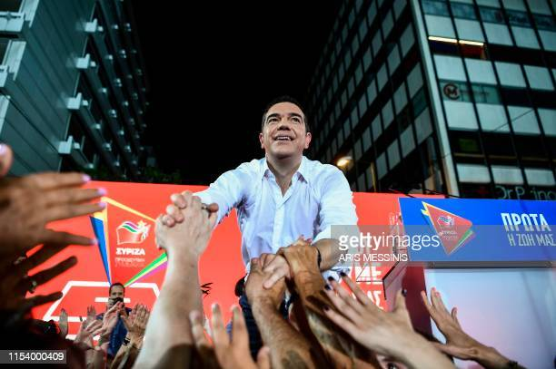 Greek Prime Minister Alexis Tsipras is cheered by his party's supporters during a preelection rally in Athens on July 5 two days ahead of general...